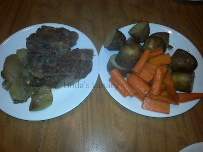Slowcooker Beef Roast with potatoes carrots onions